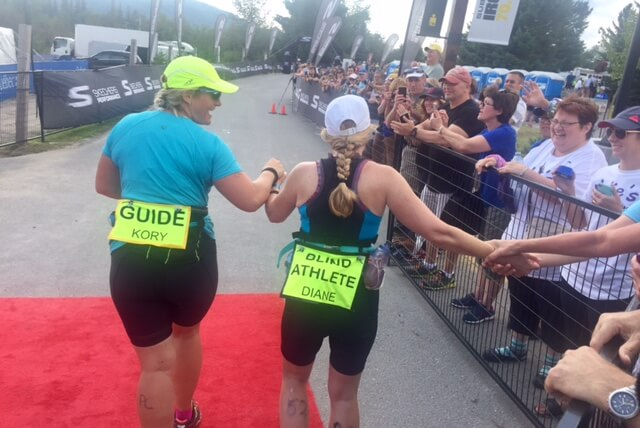 Diane and Kory Running with people cheering