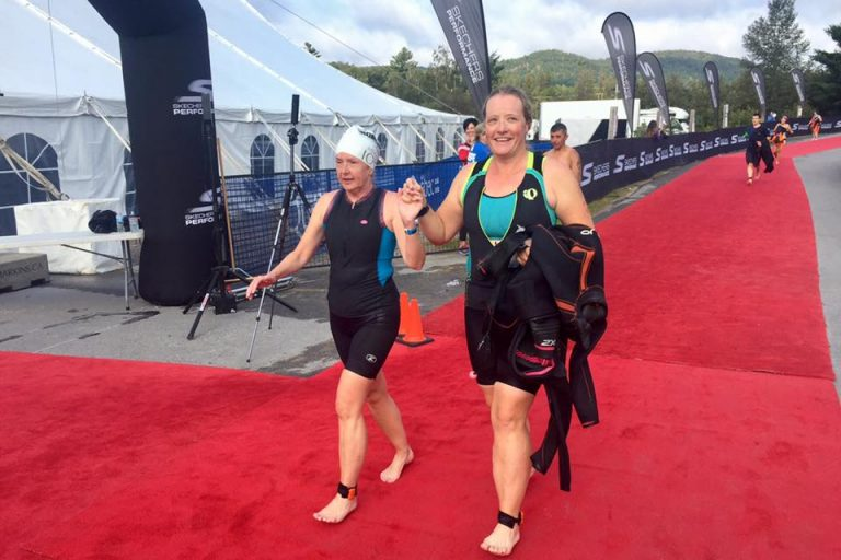Diane and Kory after swim heading in to T1
