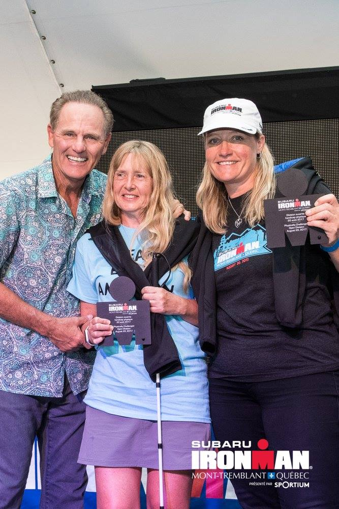 Diane and Kory at awards ceremony with Mike Reilly