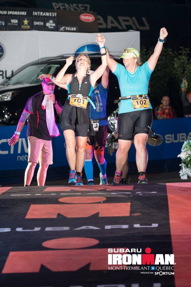 Diane and Kory crossing finish line at Mont-Tremblant Ironman