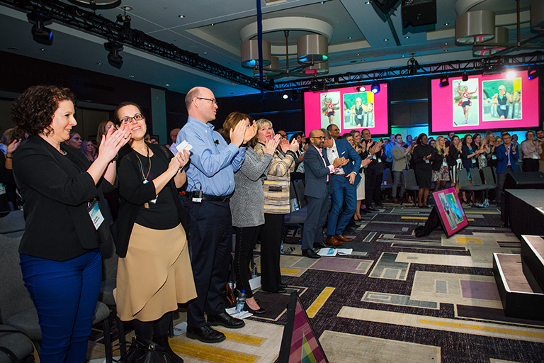 Diane and Kory Receiving a Standing Ovation Following a Presentation