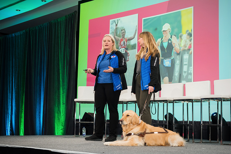 Diane, Kory and Service Dog Lucy On-Stage During Presentation